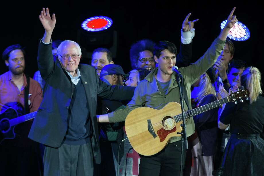 Democratic presidential candidate Sen. Bernie Sanders, I-Vt., left, and Vampire Weekend lead singer Ezra Koenig wave during a campaign rally at  the University of Iowa, Saturday, Jan. 30, 2016, in Iowa City, Iowa. (AP Photo/Evan Vucci) ORG XMIT: IAEV144 Photo: Evan Vucci / AP