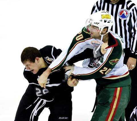 f425ab7236d Houston's John Scott lands a right to the jaw of San Antonion Rampage's  Josh Gratton during
