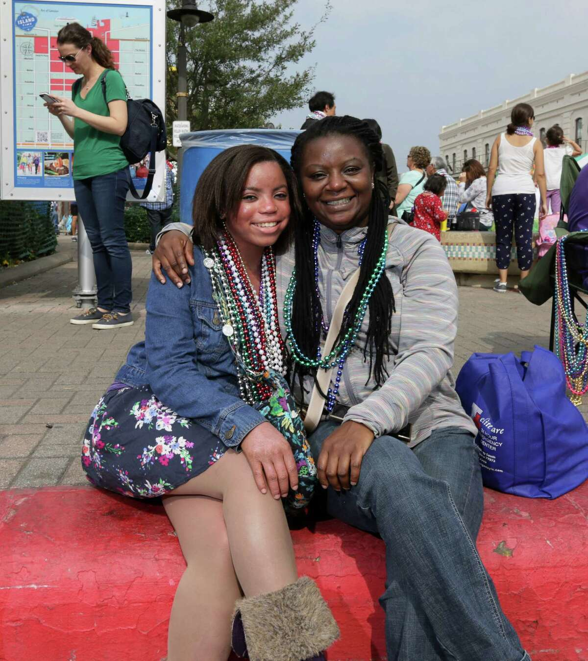 People pose for a photo before the Sunshine Kids Parade along Strand Street Sunday, Jan. 31, 2016, in Galveston.