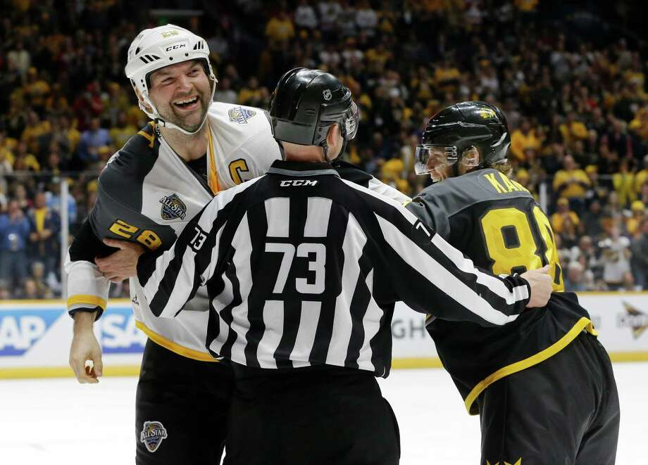 Pacific Division forward John Scott (28) and Central Division forward Patrick Kane (88), of the Chicago Blackhawks, pretend to fight after Scott knocked Kane to the ice during an NHL hockey All-Star semifinal round game Sunday, Jan. 31, 2016, in Nashville, Tenn. (AP Photo/Mark Humphrey) ORG XMIT: TNMH117 Photo: Mark Humphrey / AP