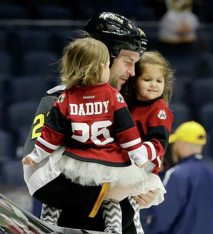 aefe3807d6e Pacific Division forward John Scott carries his children onto the ice after  being named the most