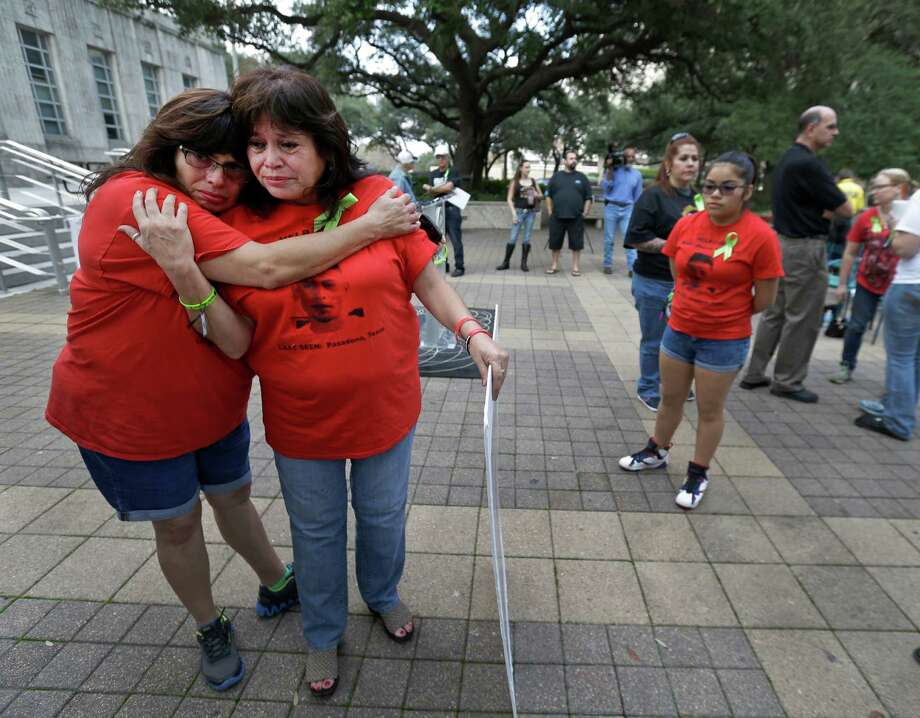 Carolyn Martinez, left, and her sister, Gloria Esparza, console each other Sunday after the Missing Person Day event at City Hall. Gloria's son, Ryan, has been missing since June 2007.  Photo: Melissa Phillip, Staff / © 2016 Houston Chronicle