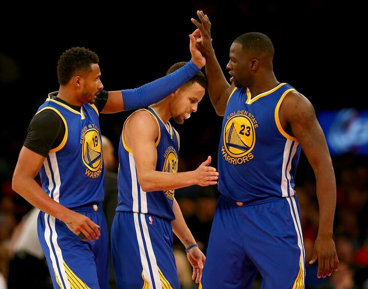 NEW YORK, NY - JANUARY 31:  Leandro Barbosa #19,Stephen Curry #30 and Draymond Green #23 of the Golden State Warriors celebrate in the second half against the New York Knicks at Madison Square Garden on January 31, 2016 in New York City. NOTE TO USER: User expressly acknowledges and agrees that, by downloading and or using this photograph, User is consenting to the terms and conditions of the Getty Images License Agreement.