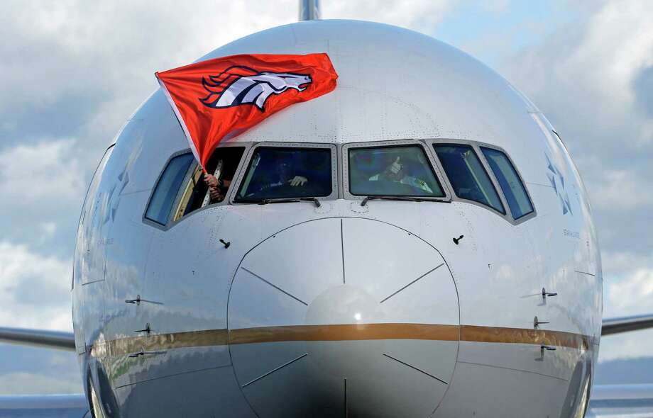 The plane carrying the Denver Broncos arrives at Mineta San Jose International Airport for the NFL Super Bowl football game Sunday, Jan. 31, 2016, in San Jose, Calif.  The Broncos play the Carolina Panthers on Sunday, Feb. 7, 2015, in Super Bowl 50. (AP Photo/Charlie Riedel) ORG XMIT: CAMG103 Photo: Charlie Riedel / AP