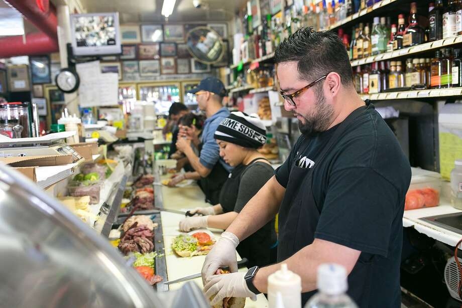 The crew makes sandwiches behind the counter of Roxie Food Center during a busy lunch period on Saturday January 30, 2016. Photo: Jen Fedrizzi, Special To The Chronicle