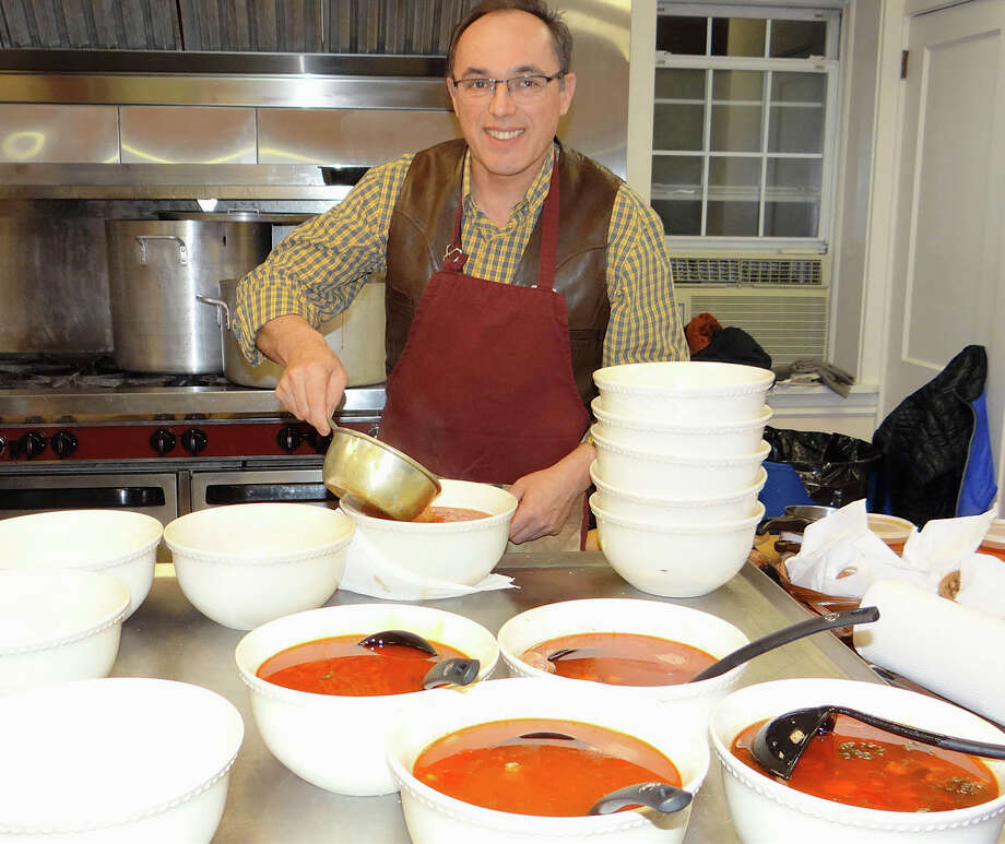 Sandor Majyar spoons out big bowls of gulyas in the kitchen at Calvin United Church's annual Hungarian gulyas dinner Saturday evening. Photo: Fairfield Citizen / Mike Lauterborn / Fairfield Citizen