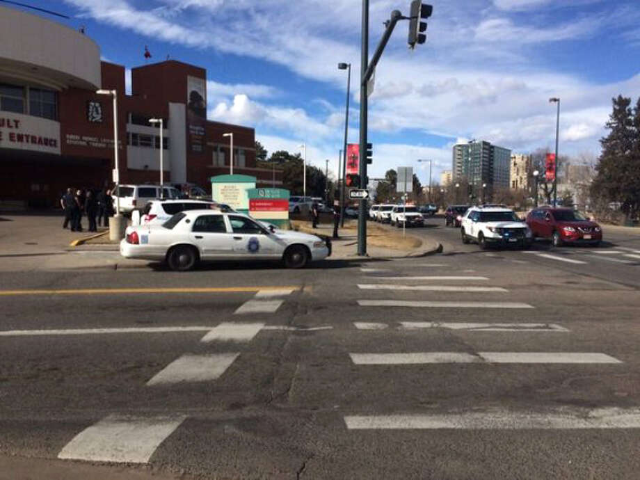 In this photo provided by 9NEWS/KUSA-TV Denver, authorities respond to the scene of a deadly shooting and stabbing at the National Western Complex, Saturday, Jan. 30, 2016, in Denver. Denver police say multiple people were injured at The Colorado Motorcycle Expo. (9NEWS/KUSA-TV Denver via AP) MANDATORY CREDIT ORG XMIT: NY118 Photo: 9NEWS/KUSA-TV Denver / 9NEWS/KUSA-TV Denver