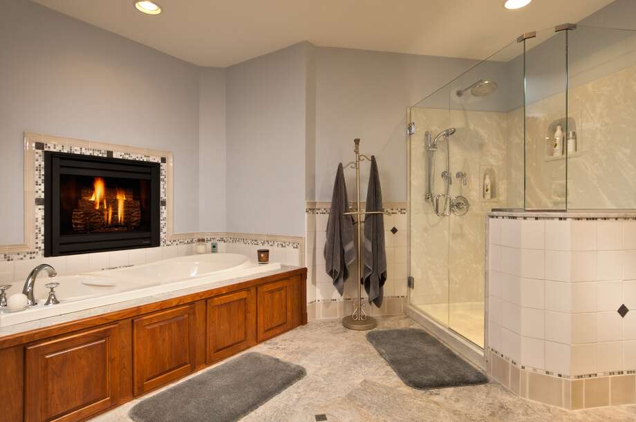 Thinking of redoing your bathroom? Take a look at some photos provided by our Times Union Home Expo Exhibitors. This custom bathroom remodel was completed by Otterbeck Builders. Visit web site. Photo: Courtesy Of Otterbeck Builders