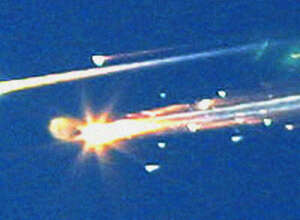 In this Feb. 1, 2003 file photo, debris from the space shuttle Columbia streaks across the sky over Tyler, Texas.  (AP Photo/Dr. Scott Lieberman, File)