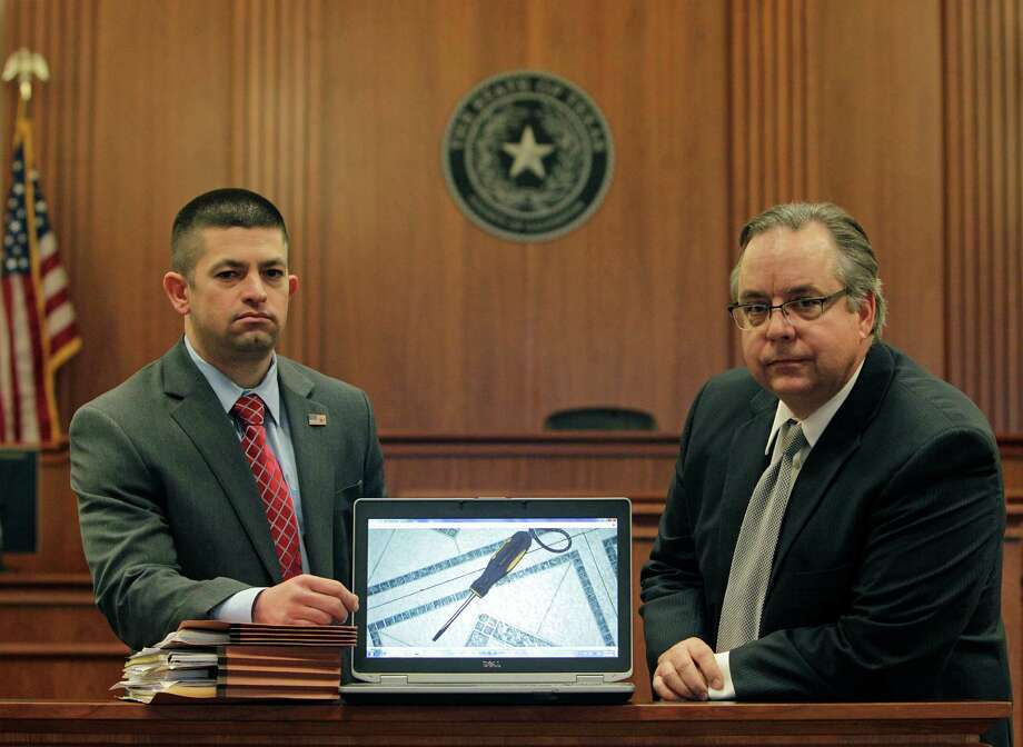 Galveston County Chief Prosecutor Matthew Shawhan (left) and Galveston County District Attorney Jack Roady pose by a photo of a screwdriver on a computer Friday, Jan. 29, 2016, in Galveston.    Matthew Shawhan, an assistant district attorney in Galveston County, prosecuted the homicide case against German Perez-Vasquez, who along with his girlfriend was convicted in slaying her ex-boyfriend with a bottle, a wireless network box and a butcher knife. Another item prosecutors thought was used in the killing was a Phillips screwdriver which belonged to the girlfriend.  DNA testing on the screwdriver handle initially showed there was 1 in 294,000,000 chance that a person other than Perez-Vasquez had touched it. The new protocol came up with a result that it was 1 in 38 chance that someone with that DNA touched it. The second run-through on the data also showed that the female defendant could not be ruled out as a DNA contributor on the screwdriver. The screwdriver ended up not being a key piece of evidence since the defense argued that the defendant killed the victim in self defense. But the screwdriver results set off a ripple effect in criminal justice circles about the need to recalculate DNA findings. ( Steve Gonzales  / Houston Chronicle  ) Photo: Steve Gonzales / Houston Chronicle / © 2016 Houston Chronicle
