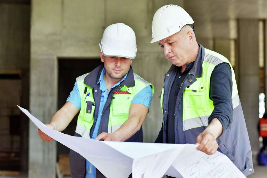 As a result of Houston's growth, there continues to be a demand for civil engineers. / iStockphoto
