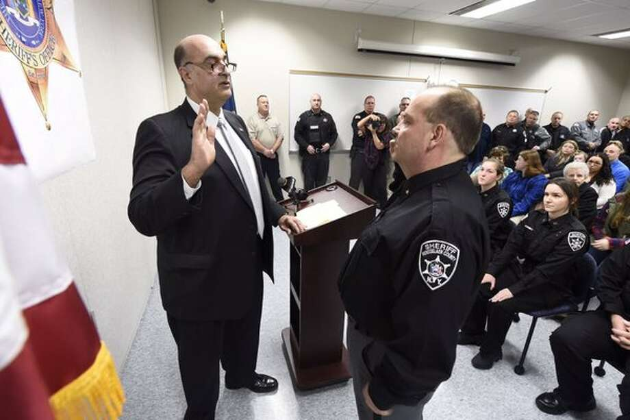 Rensselaer County Sheriff Patrick Russo, left, swears in new Corrections Chief David Hetman on Monday, Feb. 1, 2016, in Troy, NY. (Skip Dickstein/Times Union)