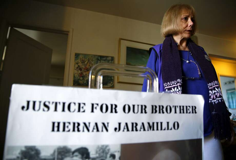Ana Biocini stands beside a sign demanding justice for her brother that she carries at protests at her home in Oakland, California, on Sunday, Jan. 31, 2016. Photo: Connor Radnovich, The Chronicle