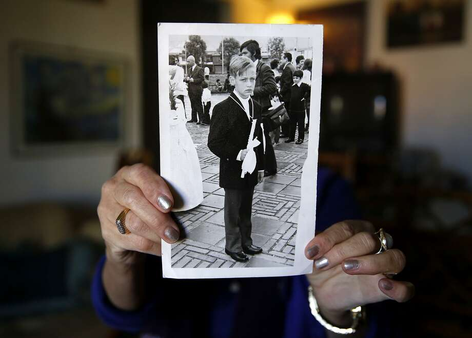 Ana Biocini holds a picture of her brother when he was a boy while at her home in Oakland, California, on Sunday, Jan. 31, 2016. Photo: Connor Radnovich, The Chronicle