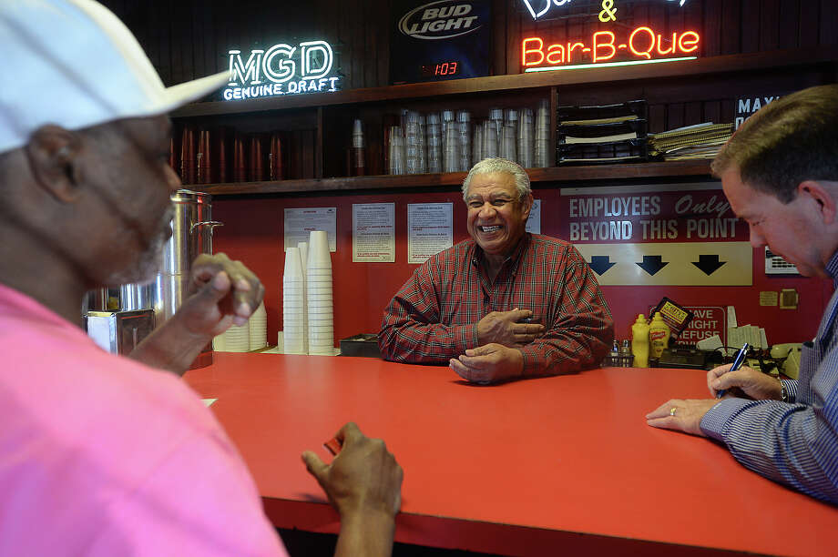"""Robert Patillo, owner of Patillo's Bar-B-Q on Washington Blvd., socializes with customers while working the lunch rush with employees Friday. Patillo's was filmed earlier this week for a short documentary piece to show when he is honored by Southern Foodways Alliance, which studies """"diverse food cultures."""" The 104-year-old establishment, which is the oldest continuously operating bar-b-que spot in Texas, is also being featured in Texas Monthly magazine.  Photo taken Thursday, January 28, 2016 Kim Brent/The Enterprise Photo: Kim Brent / Beaumont Enterprise"""