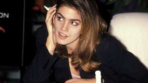 BEVERLY HILLS,CA - NOVEMBER 11:   Model Cindy Crawford promotes Halston's new perfume on November 11, 1990 at Robinsons-May Department Store in Beverly Hills, California. (Photo by Ron Galella, Ltd./WireImage) *** Local Caption *** Cindy Crawford