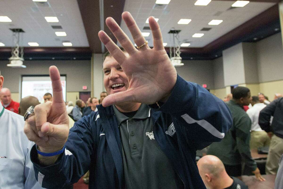 Eddy Dyer a coach with West Orange Stark High School, looks for other schools to schedule during the UIL Realignment and Reclassification at the Region 4 Education Service Center, Monday, Feb. 1, 2016, in Houston.