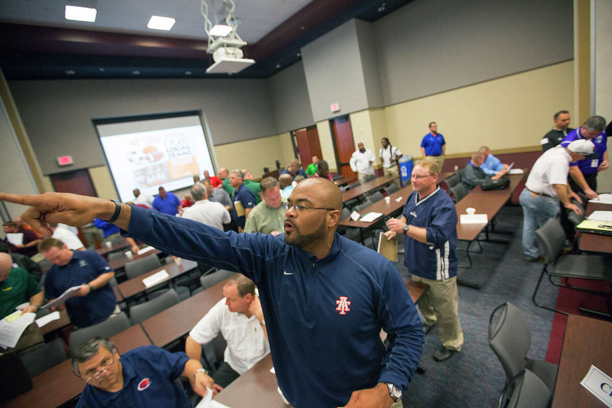 Brian Randle, a football coach with Alief Taylor High School, looks for other schools to schedule during the UIL Realignment and Reclassification at the Region 4 Education Service Center, Monday, Feb. 1, 2016, in Houston.