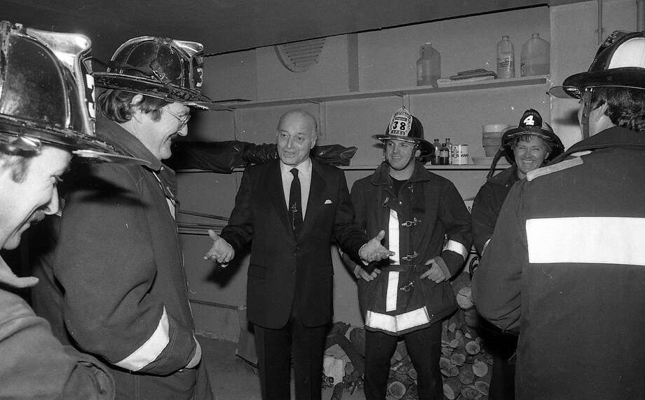 Former Mayor Joseph Alioto greets the the firefighters who showed up after reports of smoke at the Super Bowl party. Photo: Brant Ward, The Chronicle