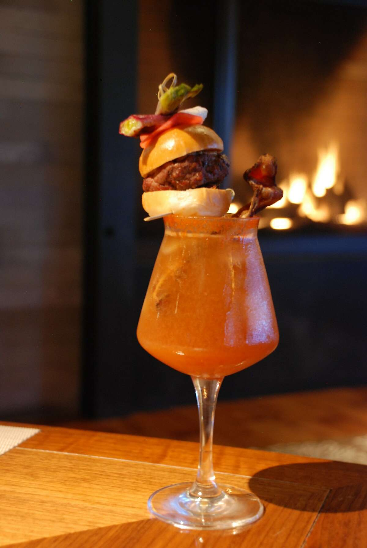 The Rosewood Sand Hill hotel has come up with a special Super Bowl drink, the Smoke & Fire, combining bourbon and beer, and topped by a slider with bacon.