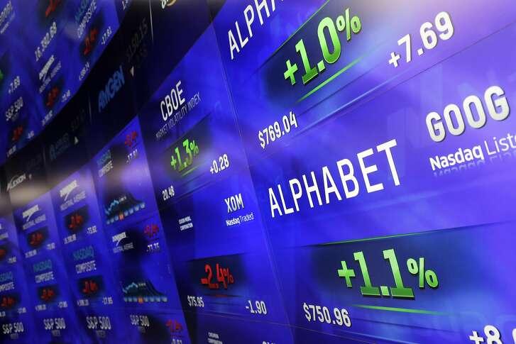 Electronic screens post prices of Alphabet stock, Monday, Feb. 1, 2016, at the Nasdaq MarketSite in New York. Alphabet, the parent company of Google, reports quarterly earnings Monday. (AP Photo/Mark Lennihan)