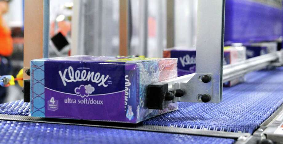 Kleenex boxes, packaged in fours, come off the assembly line at Kimberly-Clark plant in New Milford. Photo: Carol Kaliff / Hearst Cionnecticut Media File Photo / The News-Times