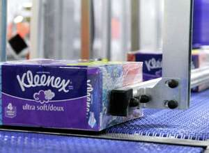 Kleenex boxes, packaged in fours, come off the assembly line at Kimberly-Clark plant in New Milford.