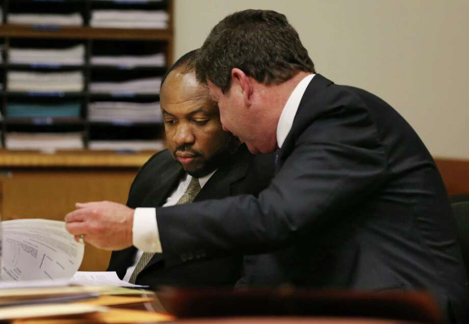 Kevin Roper, left, looks through papers with his attorney, David Glassman, during a court appearance Monday, Feb. 1, 2016, in New Brunswick, N.J. Roper, a truck driver accused of crashing into a limo van carrying comedian Tracy Morgan pleaded not guilty Monday to aggravated manslaughter and other charges in New Jersey. Roper was driving a Wal-Mart truck when the crash occurred on the New Jersey Turnpike in June 2014. The crash killed comedian James McNair and seriously injured Morgan and others.  (AP Photo/Mel Evans)     ORG XMIT: NJME104 Photo: Mel Evans / AP