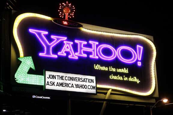FILE - In this Oct. 4, 2010 file photo, a Yahoo signboard is displayed in San Francisco.  Shares of Yahoo are up sharply before the opening bell, Wednesday, Dec. 2, 2015,  on a report that the company will discuss the sale of its Internet business. (AP Photo/Paul Sakuma)