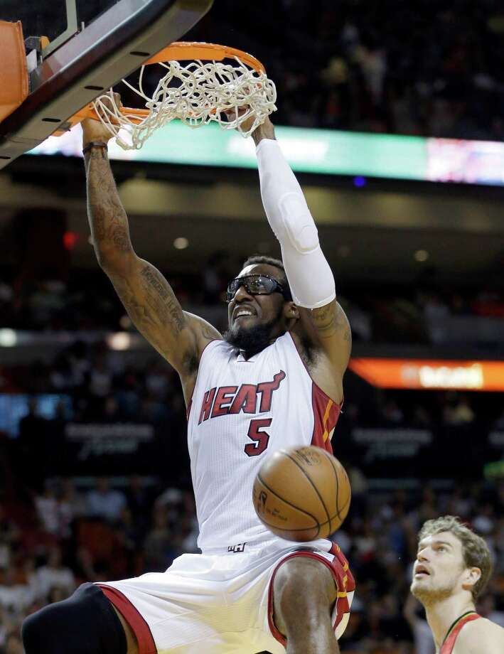 FILE - In this Jan. 31, 2016, file photo, Miami Heat forward Amare Stoudemire (5) dunks against the Atlanta Hawks during the first half of an NBA basketball game in Miami. With Hassan Whiteside hurt, Stoudemire has stepped up and the Heat are responding. (AP Photo/Alan Diaz, File) ORG XMIT: NY911 Photo: Alan Diaz / AP
