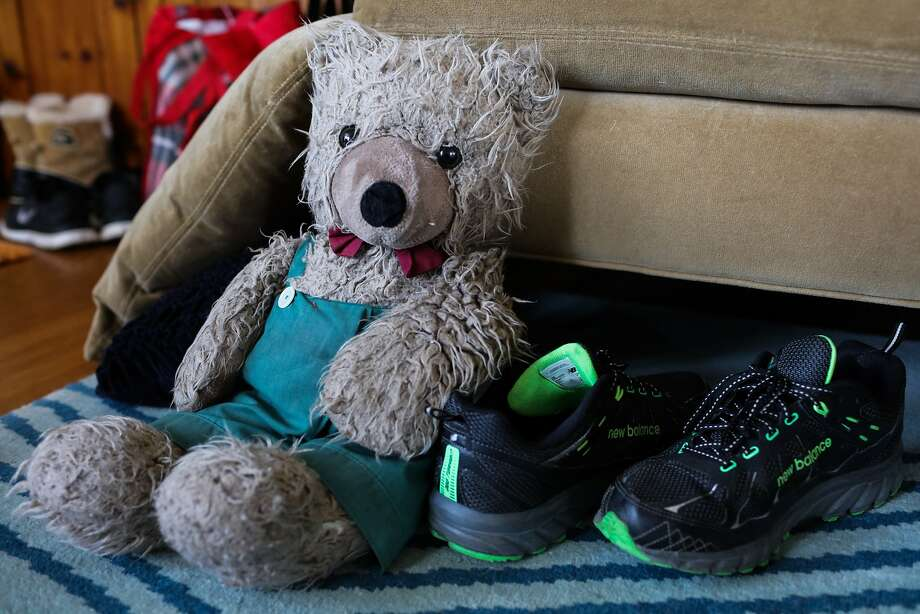 "Allison Leshefsky's stuffed teddy bear named ""Alex"" sits on the floor next to her sneakers, in Oakland, California on Saturday, January 30, 2016. Allison brings Alex with her as a security blanket despite almost all of her possessions being in storage. She has been staying with her friend Sarah M. since getting evicted from her apartment in the Castro. Photo: Gabrielle Lurie, Special To The Chronicle"