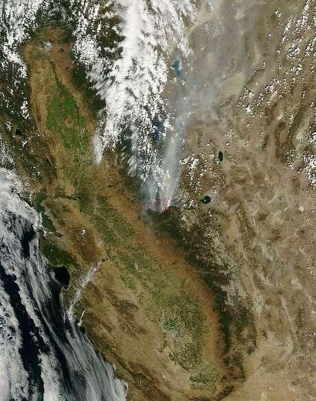 A satellite image shows the devastation of the 2013 Rim Fire near Yosemite National Park. Photo: Nasa, McClatchy-Tribune News Service