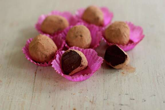 This Nov. 30, 2015 photo shows chai spice chocolate truffles in Concord, N.H. They are dark and dense orbs, made using good quality 70 percent dark chocolate infused with cream and the gorgeous sweet spices ordinarily used in chai, including ginger, cinnamon, cardamom and cloves. (AP Photo/Matthew Mead)