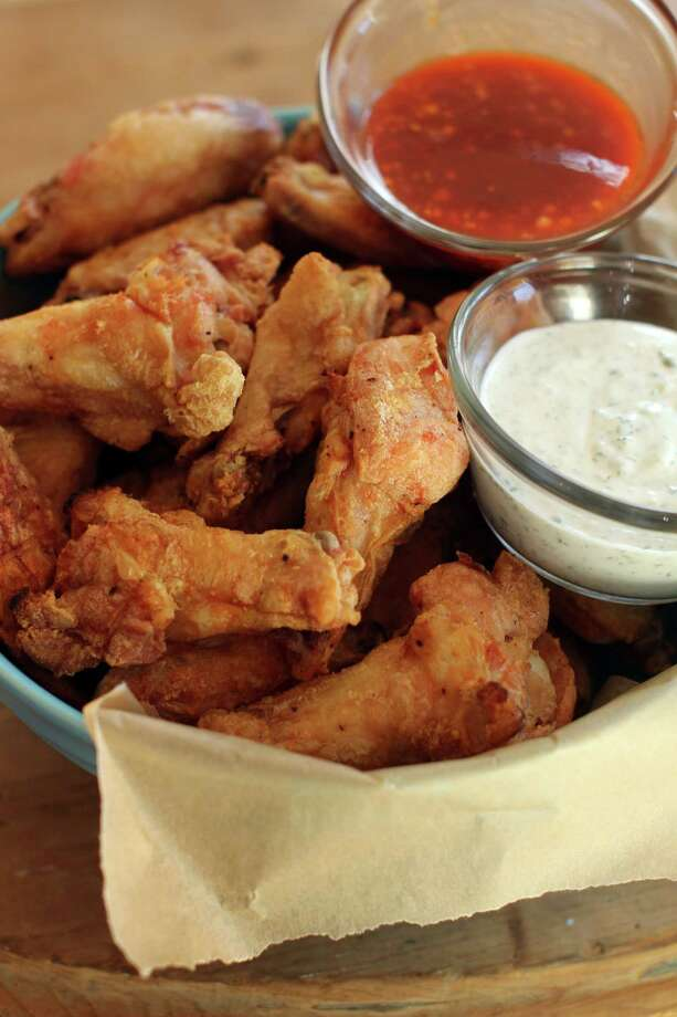Where it beganMost food historians trace the Buffalo wing to the Anchor Bar in Buffalo where, sometime in the mid-'60s, Teressa Bellissimo first prepared deep-fried chicken wings bathed in hot sauce and butter, and served with celery and blue-cheese dressing. Various members of the family tell different stories of why she did so. Photo: Matthew Mead, FRE / FR170582 AP