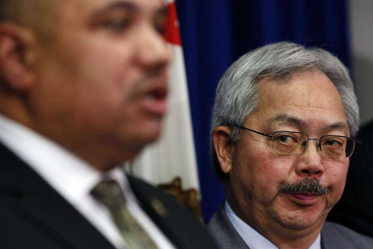 Mayor Ed Lee listens as Office of Community Oriented Policing Services Director Ronald Davis speaks during a press conference announcing a Department of Justice review of the San Francisco Police Department, at the Federal Building in San Francisco, CA Wednesday, February 1, 2016.