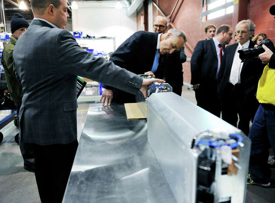 Senator Charles E. Schumer, center, is shown some of the fuel cell technology by Rick Mason, left, vice president of operations at Plug Power during a tour of the company on Monday, Feb. 1, 2016, in Latham, N.Y.   (Paul Buckowski / Times Union) Photo: PAUL BUCKOWSKI / 10035226A