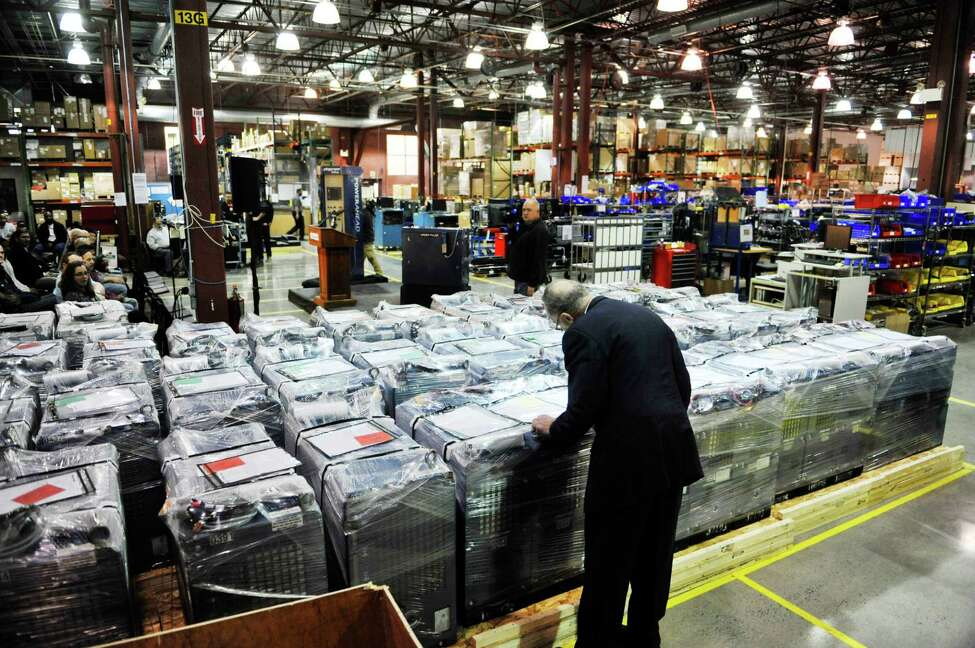 Senator Charles E. Schumer looks over rows of Plug Power GenDrive fuel cells during a tour of the company on Monday, Feb. 1, 2016, in Latham, N.Y. (Paul Buckowski / Times Union)