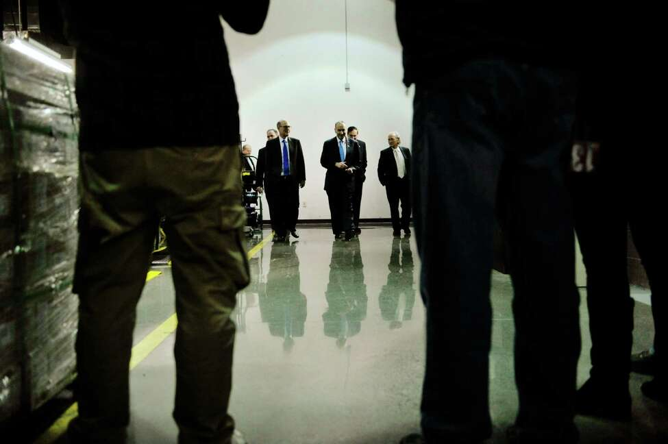 Senator Charles E. Schumer, center, takes a tour with Plug Power officials during a tour of the company on Monday, Feb. 1, 2016, in Latham, N.Y. (Paul Buckowski / Times Union)