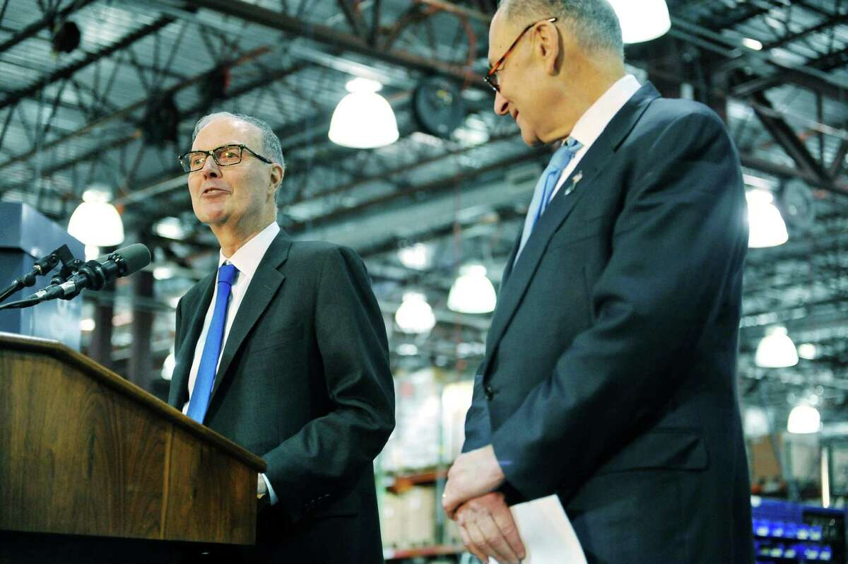 Andy Marsh, left, CEO of Plug Power and Senator Charles E. Schumer take part in an event during Senator Schumer's tour of the company on Monday, Feb. 1, 2016, in Latham, N.Y. (Paul Buckowski / Times Union)