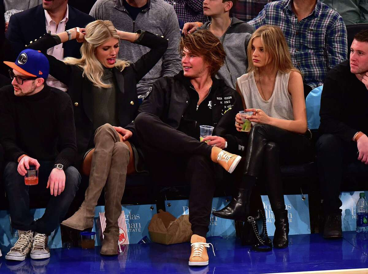 Devon Windsor, Jordan Barrett and guest attend the Golden State Warriors vs New York Knicks game at Madison Square Garden on January 31, 2016 in New York City. (Photo by James Devaney/GC Images)