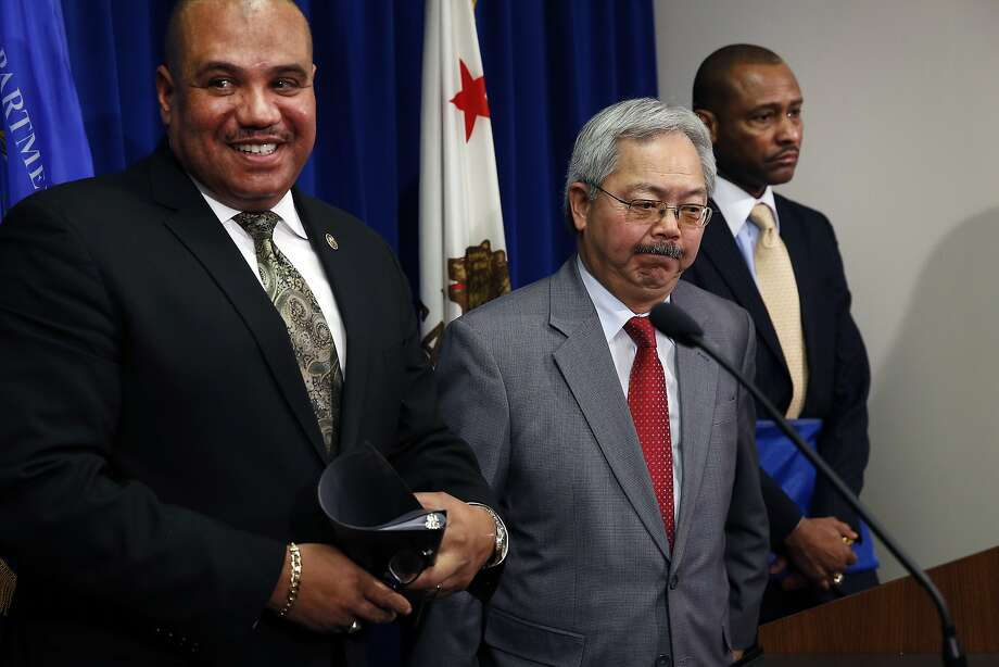 Ronald Davis (left) and Noble Wray of the federal Office of Community Oriented Policing Services flank Mayor Ed Lee at the news conference in S.F. Photo: Michael Short, Special To The Chronicle