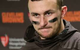 """FILE - In this Sunday, Dec. 20, 2015, file photo, Cleveland Browns quarterback Johnny Manziel speaks with media members after an NFL football game against the Seattle Seahawks, in Seattle. Tired of Manziel's off-field transgressions, some Browns fans have vowed not to discuss the quarterback on Twitter in February 2016. They've begun a """"Johnny Free February"""" movement to refrain from mentioning Manziel on their social media accounts. (AP Photo/Scott Eklund, File)"""
