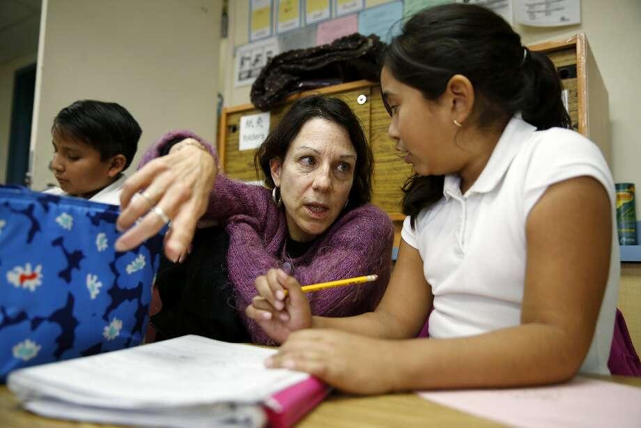 Kristen Panti helps Galilea Serrano with her math homework in a classroom at Las Americas Children Center in San Francisco, California, on Monday, Feb. 1, 2016. Photo: Connor Radnovich, The Chronicle