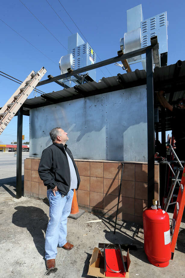 Owner Fank Garcia inspects two high velocity exhaust fans intalled on the smokehouse at Pollos Asados Los Nortenos, 4642 Rigsby Ave., on Monday, Feb. 1, 2016.  Garcia has installed new fire suppression and exhaust systems and hopes to reopen the popular Southeast Wide restaurant on Wednesday.  MARVIN PFEIFFER/ mpfeiffer@express-news.net Photo: Marvin Pfeiffer, Staff / San Antonio Express-News / Express-News 2016