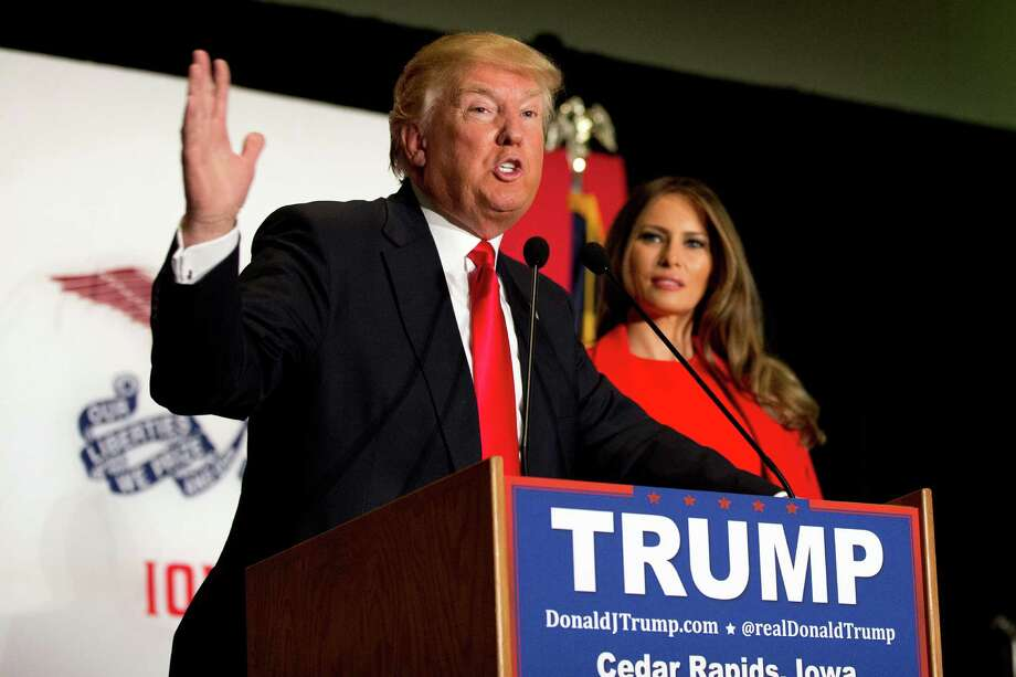 Republican presidential candidate Donald Trump is joined by his wife Melania Trump as speaks during a campaign event, Monday, Feb. 1, 2016, in Cedar Rapids, Iowa. Photo: Mary Altaffer, AP / AP