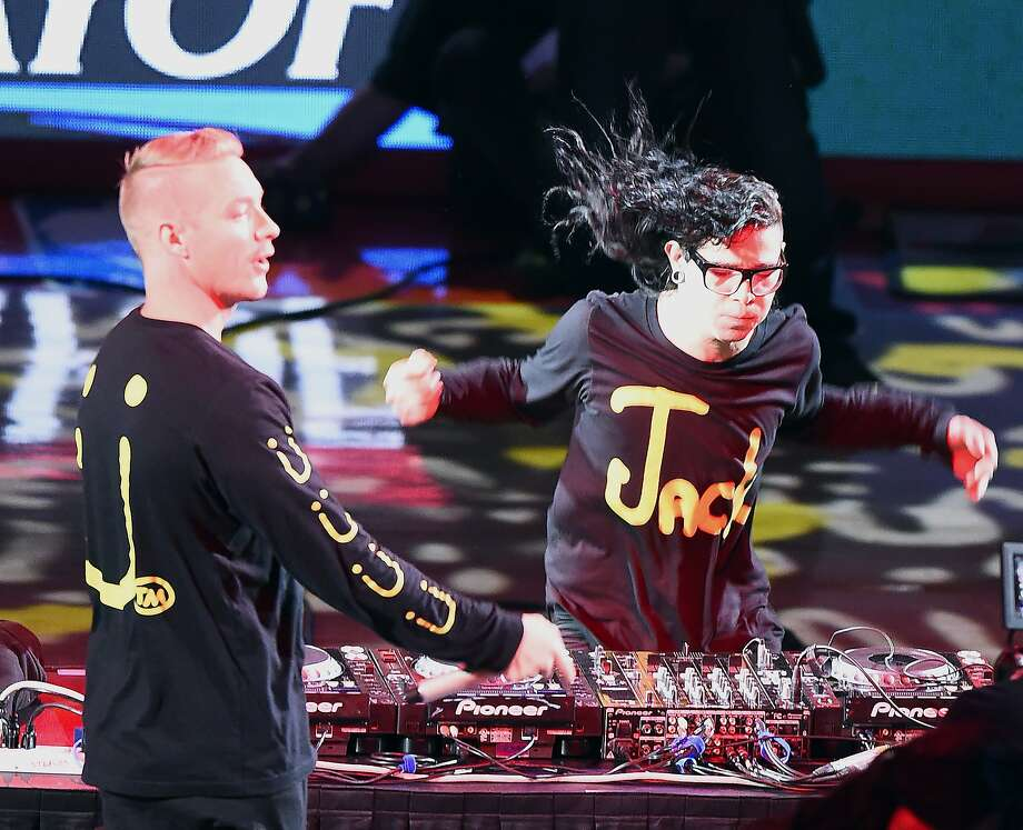 Diplo (L) and Skrillex (R) of Jack U perform at the half-time break during the Los Angeles Clippers vs Houston Rockets game four NBA playoff series basketball match on May 10, 2015 at the Staples Center in Los Angeles, California.   AFP PHOTO / ROBYN BECKROBYN BECK/AFP/Getty Images Photo: Robyn Beck, AFP / Getty Images