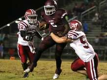 Koy Debney ,55, brings down Dontre Thomas, 5, during the game between the Silsbee Tigers and the Jasper Bulldogs at Tiger Stadium in Silsbee, Friday night November 6th, 2015 - Photo provided by Kyle Ezell