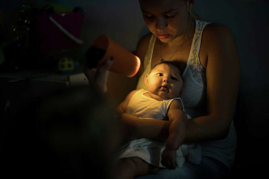 Gleyse Kelly da Silva holds her daughter Maria Giovanna, who was born with microcephaly, as she undergoes visual exams at the Altino Ventura foundation in Recife, Brazil, Thursday, Jan. 28, 2016. Brazilian officials still say they believe there's a sharp increase in cases of microcephaly and strongly suspect the Zika virus, which first appeared in the country last year, is to blame. The concern is strong enough that the U.S. Centers for Disease Control and Prevention this month warned pregnant women to reconsider visits to areas where Zika is present. Photo: Felipe Dana /Associated Press / AP