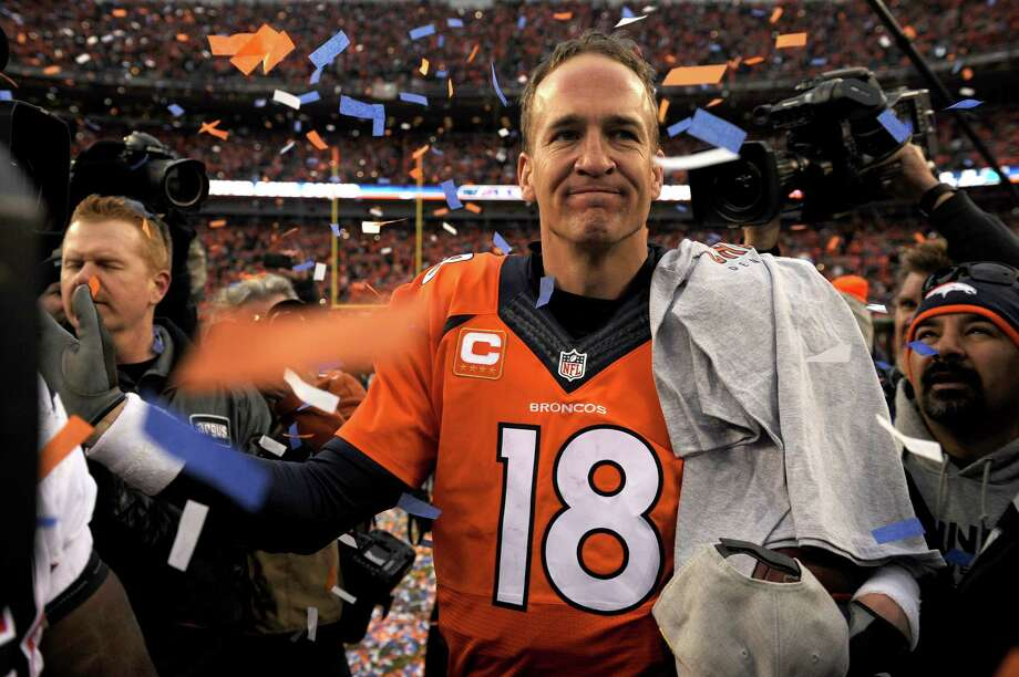 DENVER, CO - JANUARY 24:  Peyton Manning #18 of the Denver Broncos walks off the field after defeating the New England Patriots in the AFC Championship game at Sports Authority Field at Mile High on January 24, 2016 in Denver, Colorado. The Broncos defeated the Patriots 20-18.  (Photo by Dustin Bradford/Getty Images) ORG XMIT: 600930835 Photo: Dustin Bradford / 2016 Getty Images