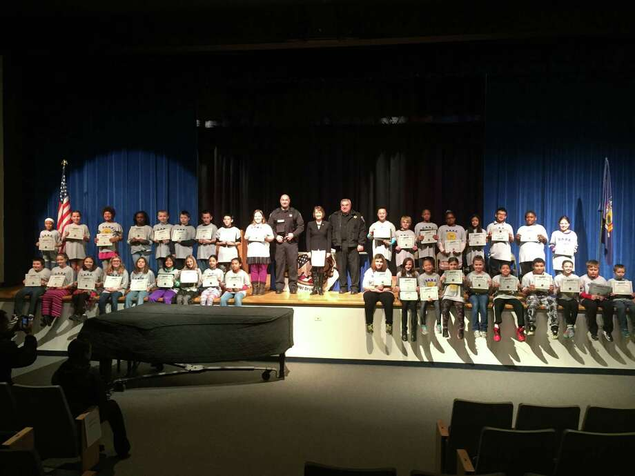 Van Rensselaer Elementary School conducted its fifth-grade DARE graduation Wednesday  in a ceremony hosted by Rensselaer County Sheriff's Deputy and DARE officer Jeff Russo, County Executive Kathy Jimino and Undersheriff Ed Bly. (Brad Endres)